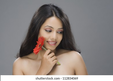 Close-up of a young woman holding a flower