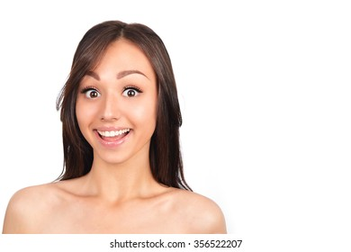 Close-up of a young woman looking surprised on white background