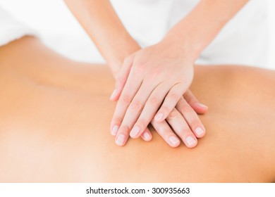 Close-up of a young woman receiving back massage at spa center