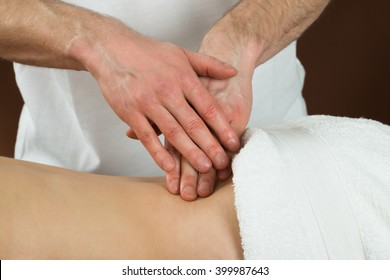 Close-up Of A Young Woman Receiving Back Massage In A Beauty Spa