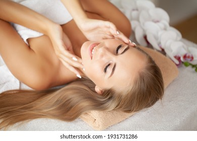 Close-up of a young woman receiving spa treatment.