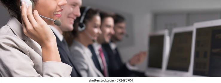 Close-up of young woman working in call center company as a telemarketer