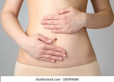 Closeup of a young woman's abdomen and hands