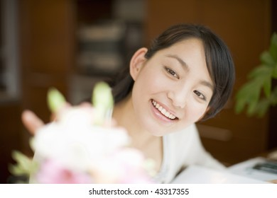 Close-up young woman's face with flowers