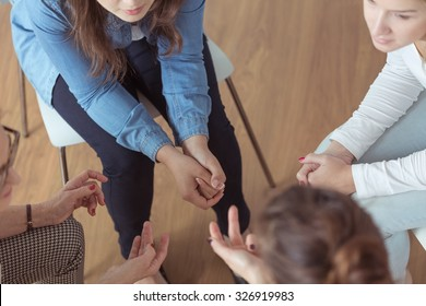 Close-up of young women brainstorming during meeting