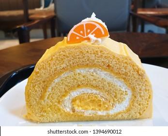 Closeup yuzu orange roll on the white plate.