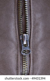 closeup of the zipper of a brown cloth made from hemp