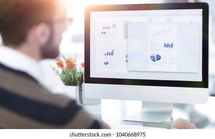 closeup.a businessman looks at the marketing scheme