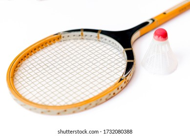 Close-up.Badminton concept.Racket and shuttlecock.Badminton racket and white shuttlecock with red cap on white background.
