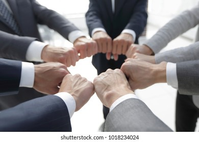 closeup.business people show a circle of hands.