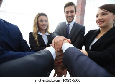 closeup.business team with hands clasped together