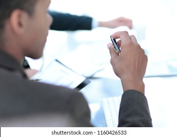 closeup.Executive businessman sitting at the table in office