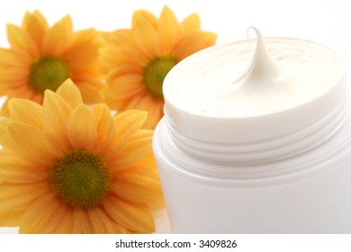 close-ups of face cream and daisy isolated