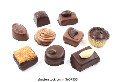 close-ups of mixed chocolates isolated on white