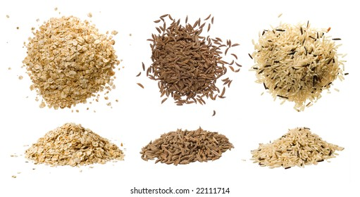 Closeups of oatmeal flakes, long rice mixed with wild rice and dried caraway isolated on white