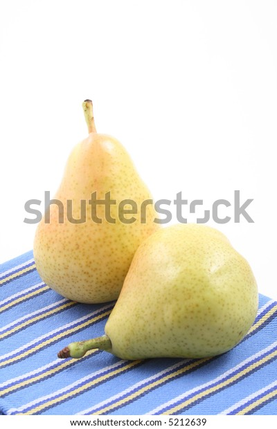 close-ups of two delicious pears on white
