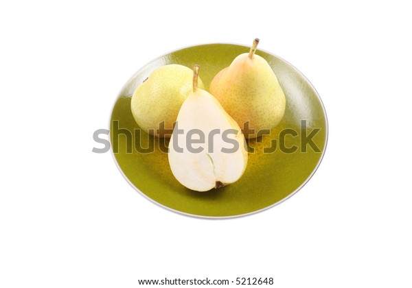 close-ups of two delicious pears on plate isolated on white