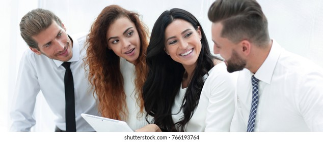 closeup.smiling business team with tablet computer