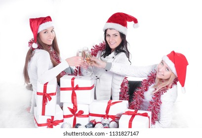 closeup.three young women in hats of Santa Claus with Christmas