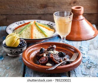 Closeview of tajine of beef with prunes and almonds. In tradiotional Moroccan dish.