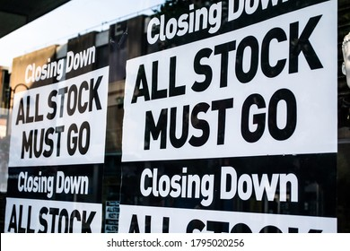 CLOSING DOWN ALL STOCK MUST GO signs in a shop window: UK officially in recession for first time in 11 years
