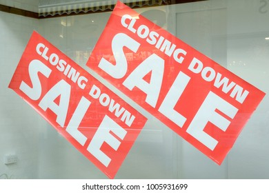 Closing Down Sale signs in shop window