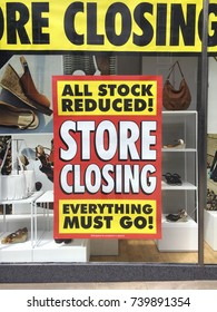 Closing Down Sign in a shop window - All Stock reduced