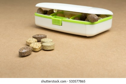 Closse up of herb Medicine in the drug box on brown paper board