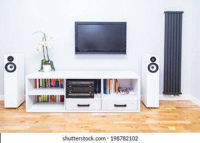 A closup of modern living room equipment with TV and stereo