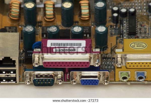 Closup of rear of computer mainboard, showing input & output connectors.
