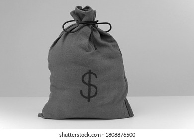 A Cloth Money Bag With A Dollar Symbol On The Front.