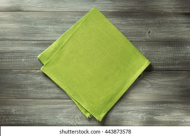 cloth napkin on wooden table background
