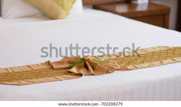 cloth on the bed in luxury style in earth tone colour for holiday and relax