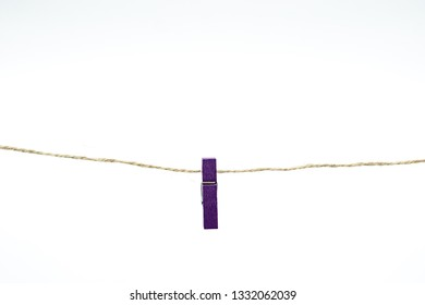 Cloth peg isolated on white background. Purple color.
