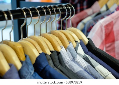 Cloth rack with man shirts in department store selective focus