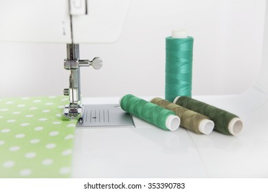 a cloth is sewn with a sewing machine, yarn of different colors