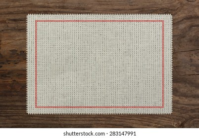 cloth table edge fabric torn, red stitch cross border