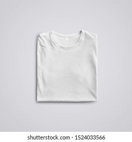 Cloth template.  Folded  blank T-shirt  with shadows  lying on the studio background. Top of view. Mockup ready to use in your design.