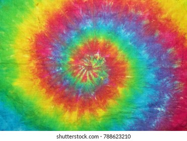 cloth tie dyed into a spiral rainbow pattern