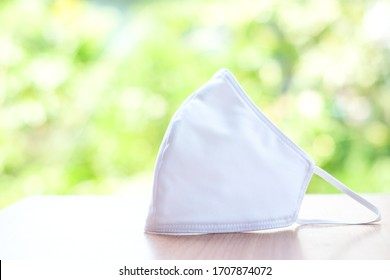 Cloth white mask isolated on nature background - for prevent dust (PM 2.5),  disease (Coronavirus or COVID-19).