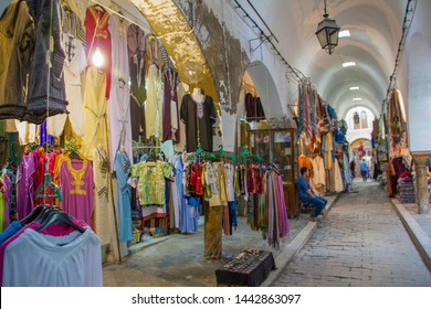 Clothe store with hanged djellabas from the souk / bazaar market at Medina of Tunis (Tunisia)