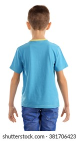 Clothes advertising. Boy in blue T-shirt and jeans isolated on white background, back view