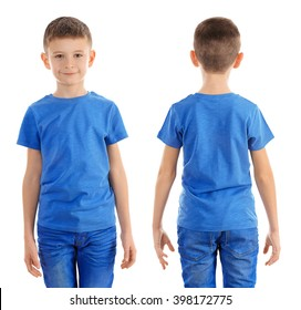 Clothes advertising. Boy in blue T-shirt and jeans isolated on white background