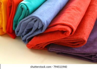 Clothes as background / Clothing is a collective term for garments, items worn on the body. Clothing can be made of textiles, animal skin, or other thin sheets of materials put together