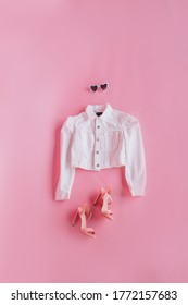 clothes for barbie suit shoes on a pink background