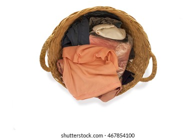Clothes in a basket for stock laundry on isolated on white background.