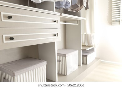 Clothes and boxes in wardrobe