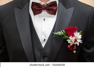 Clothes of a bridegroom close-up. Costume, shirt, tie and buttonhole.