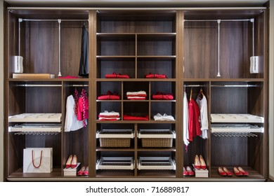 Clothes in built in closet made of wood