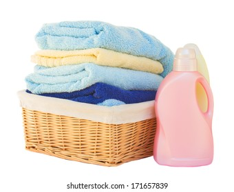 Clothes with detergent  in basket isolated on white background
